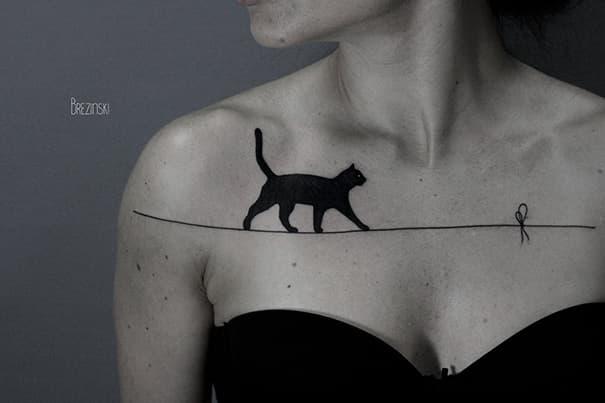 gato equilibrios tatuaje